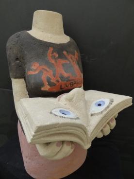 Tête dans les livres, pierre de Savonnières, taille directe